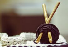 knitting accessories and a blanket